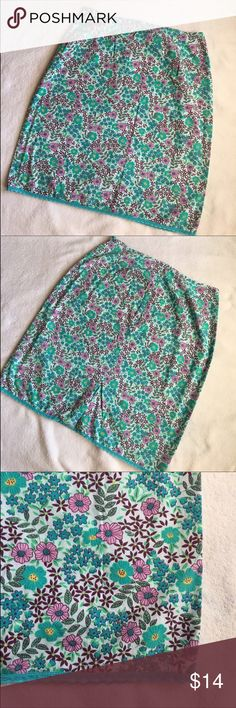 Floral Skirt with Scalloped Trim Cute skirt! Waist: 15 in. Length: 22 1/2 in. Zips up the back. 6 in. slit in the back. Size medium. 100% cotton. Good used condition. All measurements taken laying flat. Greenish/Blue color. Xhilaration Skirts