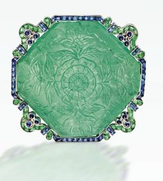 A VERY RARE PLATINUM, CARVED EMERALD, EMERALD AND SAPPHIRE BROOCH, CARTIER, NEW YORK, CIRCA 1920. Sotheby's.