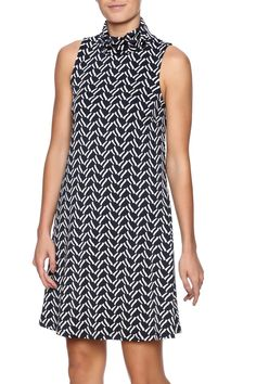 Sleeveless navy printed shift dress with a turtleneck and back zipper closure.Machine washable   Sleeveless Turtleneck Dress by Julie Brown NYC. Clothing - Dresses - Printed Pennsylvania