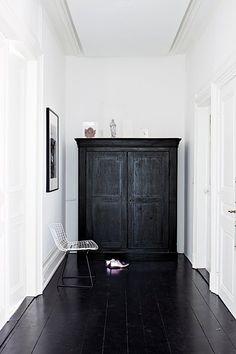 dark floors, white walls