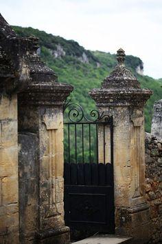 Distressed Stone Pillars with Black Intricate Gate