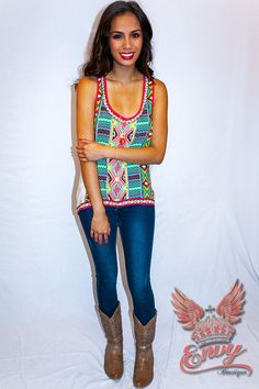 Julep Aztec Tank - Bold and vivid tribal stripes collide in an intricate and eclectic aztec design. Giving this vibrant racer-back tank a lively essence. It's edgy and eccentric. Spunky and cool. And a little fun in the in the obvious high-low hem giving a retro air. A bold pop of design to pair against jeans or shorts for a cool bohemian look.  - available online at http://www.envyboutique.us/shop/julep-tank/ #Envy #Boutique #chic #fashion #fashiontrends #HiloTank, #Tank,