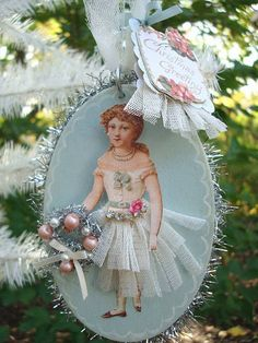 An ornament to make from a vintage looking card or paper doll