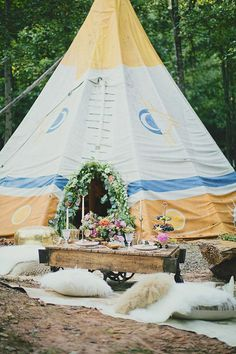STYLE FOR YOUR GLAMPING VENUE SETTING | This tipi fuzed with colorful florals transforms the setting into an elegant affair.