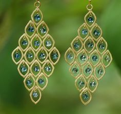 22kt gold earrings with blue-green faceted tourmaline beads.