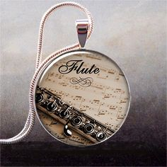 Flute and Music pendant, flute pendant flute jewelry, flute necklace charm, music teacher gift by thependantemporium on Etsy https://www.etsy.com/listing/62398521/flute-and-music-pendant-flute-pendant