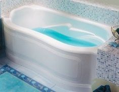 The Alcove Celine bathtub is designed to curve around your body. The front skirt curves out to provide more bathing area. An elegant 3 panel style design graces the skirt. Raised backrest cradles your head and the curving armrest add to the comfort. Three sided tile flange is included for the alcove installation.