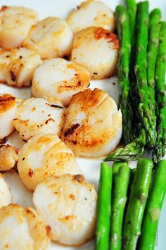 Seared Scallops-Quick to prepare with a little lemon, butter and garlic.     •1 pound large sea scallops  •1 tablespoon salted butter  •1 tablespoon olive oil  •For the pan sauce:  •¼ cup dry white wine or chicken stock  •2 tablespoons salted butter  •1 medium shallot, finely diced  •1 clove garlic, minced  •salt and pepper, to taste