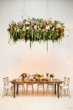 Decorate your wedding with suspended flower garlands.