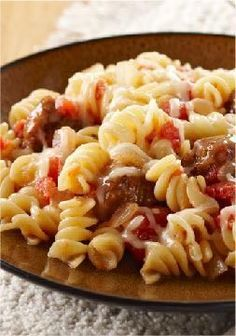 Quick & Cheesy Sausage Rotini – Toss diced tomatoes and seasoned Italian sausage with cooked pasta, then sprinkle with mozzarella cheese to add a melty finish to this quick and easy weeknight dish.