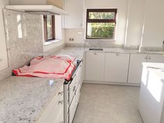 Small kitchen with colonial white granite