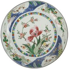 A Chinese export porcelain famille rose plate painted with a dutch decoration. Yongzheng period. China/Asia. Decorated in the famille rose palette, with flowers.