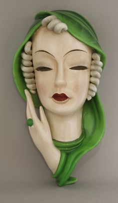 A Goldscheider pottery wall mask, modelled as a lady with curled hair and a green scarf, printed mark, impressed and initials 'F. Goldscheider, Art Nouveau, Ceramic Mask, Chef D Oeuvre, Art Deco Furniture, Art Deco Era, Vintage Ornaments, Hand Painted Ceramics, Art Deco Design