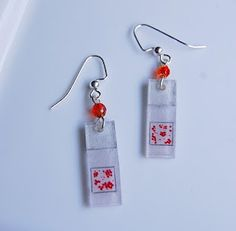 Microscope slide earrings. This Etsy seller makes tons of science jewelry. I want!