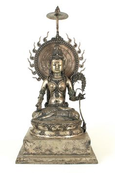 Devi Sri on throne - Beautiful Indonesian Hindu statue