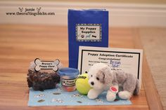ending favor result: puppy, sleeping mat, puppy treats (in this pic: cocco puffs), tennis ball, adoption certificate, collar w/ tag from scrapbook tag, vitamins