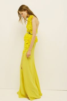 Nina Ricci. bright yellow. halter. floral embroidery. high slit.