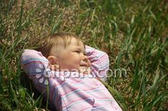Clipart.com Closeup   Royalty-Free Image of carefree,caucasian,caucasians,child,childhood,children,female,females,field,fields,fun,girl,girls,grass,grassy,happiness,kid,kids,lie,lies,lying,meadow,meadows,nature,outdoor,outdoors,outside,people,person,rest,resting,rests,season,seasonal,seasons,spring,springtime,summer,summertime,tot,tots,youngster,youngsters,youth,youths