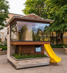 My kids would have a hard time keeping me out of this playhouse if we owned it. I love the wrap around floor to ceiling glass window.