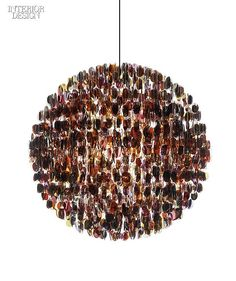 How fun is this....Sunglass frames composing another chandelier by Stuart Haygarth.