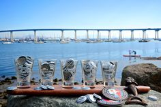 Coronado Brewing Company bottle caps enjoying the view of the San Diego Bay and Coronado Bridge from a taster set.