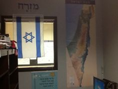 Israel- Hatikvah, mizrach, photos, map, flag, chamsa or anything else you can come up with should be permanently displayed. Jewish=Israel.