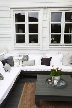 I want to do built in couches like this in a rectangular shape around a patio area that can fit a 10 person table, or a table that could expand to seat 12. How should it be covered though? Awning/pergola?