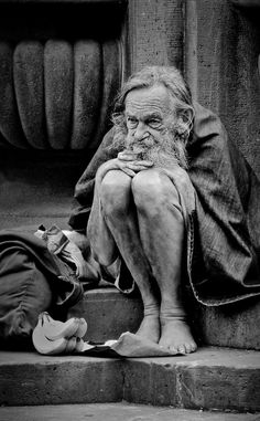 When compared to mine his dreams are very humble he does not seek much out of life at all. At sixty seven years he's on the street and homeless a Winter dawn is breaking cold and gray With long gray beard and looking thin and shabby he walks uptown as he does every day.