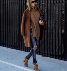 Ripped denim jeans, ankle boots , dark camel coat outfit