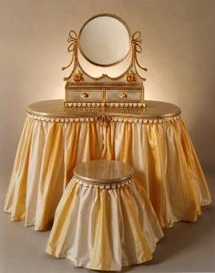 Wow, the first picture of a vanity with a skirt and a stool with a skirt, that I come across on Pinterest, is really bright!  Although I think this is pretty, I don't know if I'd want to have one in golden yellow tones.