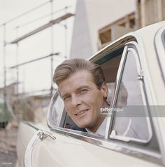 english-actor-roger-moore-who-plays-simon-templar-in-the-television-picture-id535528897 (1014×1024)