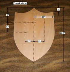 With the right plan, materials, and equipment, you can build this simple Wood Medieval Shield, as shown here.