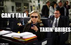 Can't talk. Takin' bribes.