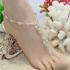 HuaYang Crystal Imitation Pearl Light Brown Beads Barefoot Sandals Adorn Extensible Foot Ring Anklet Chain HuaYang http://www.amazon.com/dp/B00K1917PW/ref=cm_sw_r_pi_dp_2aVQub13PTA94
