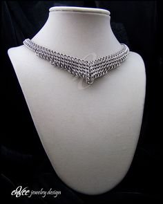"""Art-Deco stainless steel necklace... 496 individual stainless steel rings woven in a tight sheet weave (Half-Persian 3-1, Sheet 6), mirrored, and joined in the middle with a graduated """"Persian Teardrop"""". Adjustable from 16-17"""", weighs just over 2 ounces"""