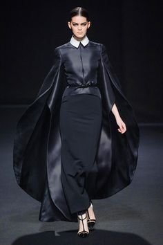 Stephane Rolland fall 2013 haute couture (she looks like the avenging puritan schoolteacher, but I like it)