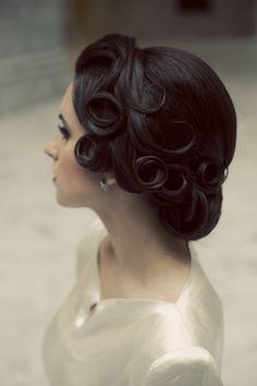 Sleek updo with pincurls