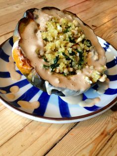 acorn squash stuffed with greek millet and lemon tahini dressing - BeginWithin Nutrition