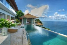 Villa Liberty, a stunning five-level luxury oceanfront villa on Phuket's 'Millionaires Mile'. The pool offers views of the crystal Andamean Sea