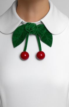DETAIL: Turndown collar with fixed decorative cherries.