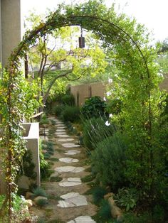 "So pretty. I have the perfect side yard for this design. ""Learn how to cultivate big style in a small garden with these small garden design tips from landscape designer Shirley Bovshow, who transformed this narrow side yard into a charming passageway. Pergola Garden, Backyard Landscaping, Landscaping Ideas, Garden Archway, Walkway Ideas, Garden Entrance, Garden Trellis, Backyard Ideas, Sideyard Ideas"