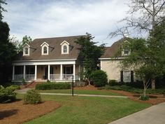 Deep waterfront can accommodate a large boat; lift and dock; close to Trent River; large front porch typical of low country home in New Bern, NC