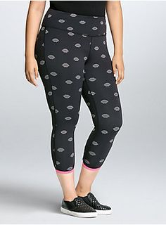 this black and grey lip print legging has 4-way stretch fabric that maintains its shape and flat seam construction that improves your mobility. A cinched back leg adds flattery to the crop cut, wicking technology keeps you cool and dry, a high waistband smooths your tummy.