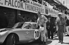 Bob Holbert with the Daytona Coupe at Sebring, 1964. Holbert and co driver Dave MacDonald had built a very large lead overall, but a pit fire put the car behind the wall.