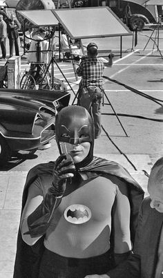 "Adam West, star of the ABC-TV series ""Batman,"" stands beside the Batmobile while using his ""Bat Radio"" on the set in Hollywood on March 1966 Batman Show, Real Batman, Batman Y Robin, Batman Tv Series, Batman 1966, Im Batman, Batman Stuff, Batman Logo, Batgirl"