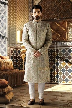 AQUA GREEN SHERWANI Special piece for the groom.This celebration wear sherwani in aqua green made with raw silk is sure to make heads turn.The intricate heavy embroidery all over enhances the overall look for the occasion. Sherwani For Boys, Sherwani For Men Wedding, Wedding Dresses Men Indian, Groom Wedding Dress, Mens Sherwani, Sherwani Groom, Wedding Men, Wedding Goals, Indian Groom Dress
