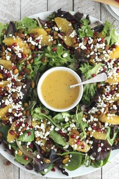 This easy, beautiful Christmas salad can even be served as a wreath! Pistachios, pomegranate, oranges and goat cheese with a light champagne vinaigrette.