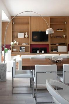 Apartment in Paris by Ramseyer Architectes with Flos Arco