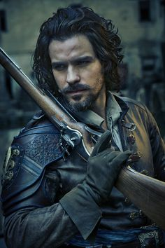 The Musketeers - Season 3 - Aramis. I would love to play this part on an on-going basis and regularly undergo the makeup of having a lace wig fitted in that hairstyle and have that moustache and beard applied to my face. This character face looks so hot. Aramis The Musketeers, The Three Musketeers, Conquistador, Milady De Winter, Bbc Tv Shows, Luke Pasqualino, Tom Burke, Bbc Drama, Medieval Clothing