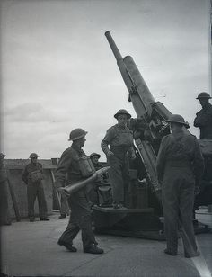 British troops training. Firing with a 3.7 inch anti-aircraft gun. Probably late 1940.
